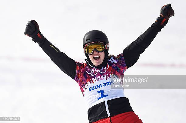 Patrizia Kummer of Switzerland reacts during the Snowboard Ladies' Parallel Giant Slalom Semifinals on day twelve of the 2014 Winter Olympics at Rosa...