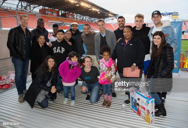 Patrizia McQueen and Sandra Portillo along with Alexi Lalas Eddie Johnson Dwayen De Rosario Charlie Davis Stu Holden Chris Wondolowski Jake Paul and...