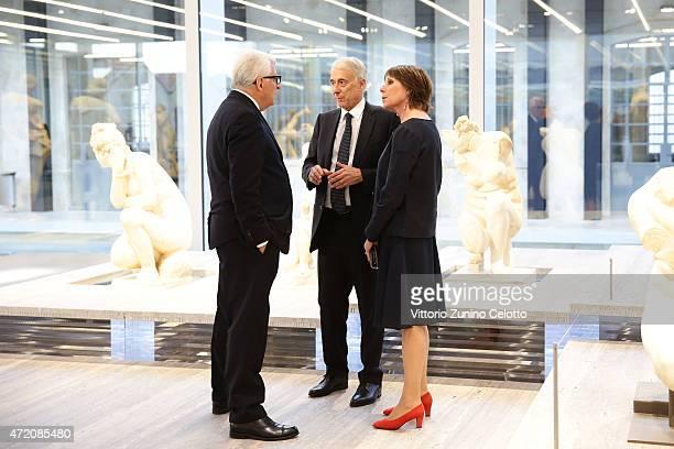 Patrizio Bertelli , Giuliano Pisapia and Cinzia Pisapia attends he Fondazione Prada Opening on May 3, 2015 in Milan, Italy.