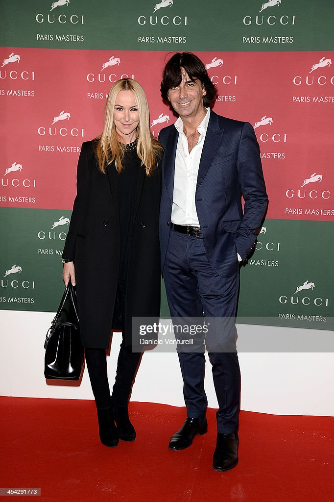 Patrizio Di Marco and Frida Giannini attend day 4 of the Gucci Paris Masters 2013 at Paris Nord Villepinte on December 8, 2013 in Paris, France.