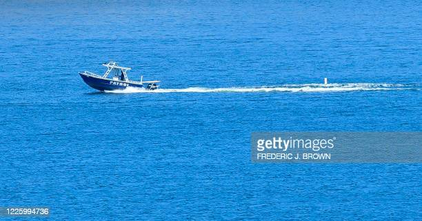 A patrol boat is seen on Lake Piru in the Los Padres National Forest Ventura County California on July 9 2020 as the search continues for actress...