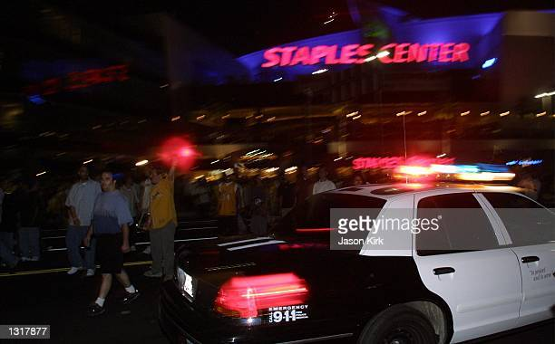 LAPD patrol car drives in front of the Staples Center after the lakers won the NBA championships June 15 2001 in Los Angeles CA The Los Angeles...