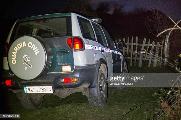A patrol car of Spanish Guardia Civil is parked in La Roza rural area near Cangas de Onis where a helicopter that was battling a fire crashed on...