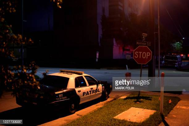 Patrol car sits outside of the Chinese consulate on July 22 in Houston after the US State Department ordered China to close the consulate. - The US...