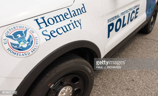 A patrol car with the Department of Homeland Security logo blocks the street outside the Department of Veterans Affairs July 27 in Washington DC /...