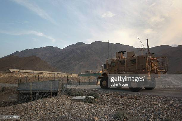 S patrol driving in a Mine Resistant Ambush Protected vehicle moves out of Forward Operating Base Torkham on August 26 2011 in Torkham Afghanistan...
