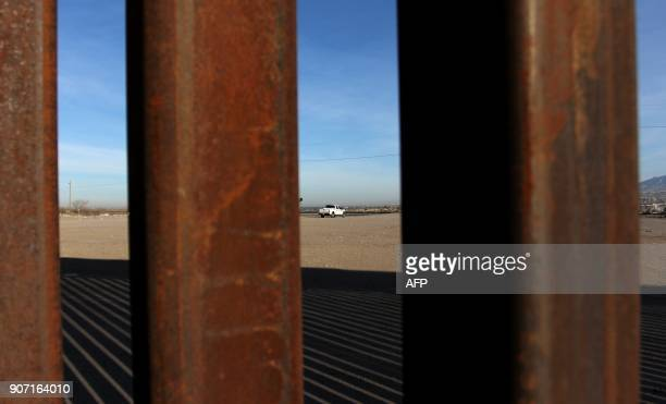 A US patrol is pictured through the border wall that divides Mexico from the United States in Ciudad Juarez Chihuahua state Mexico January 19 2018...
