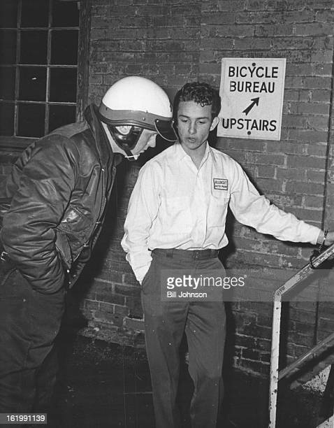 APR 13 1965 APR 14 1966 Patrolman James Snider Questions Burglary Suspect Henry A Gutierrez 1635 Pennsylvania St is handcuffed to police garage...