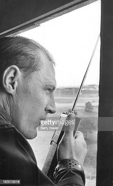 APR 27 1971 MAY 7 1971 MAY 11 1971 Patrolman R E Gray radios from an observation tower at the Valley Highway and Interstate 70 Tower gives view of...
