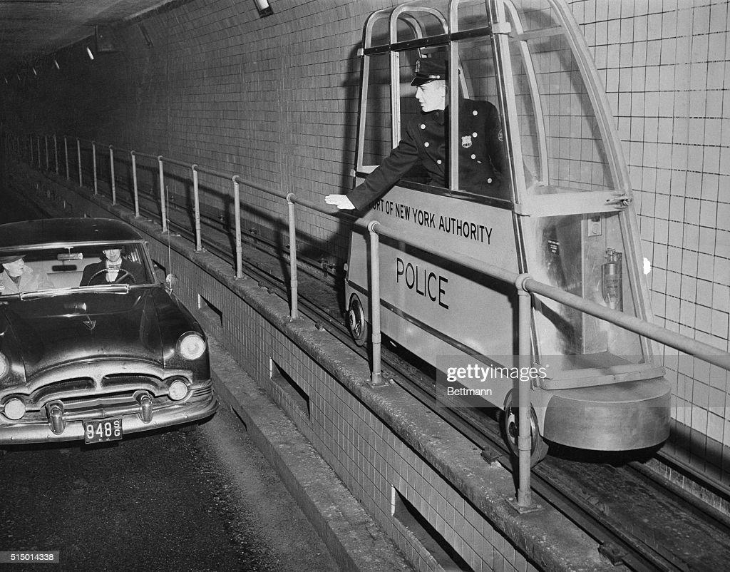 Policeman Driving a Catwalk Car : News Photo