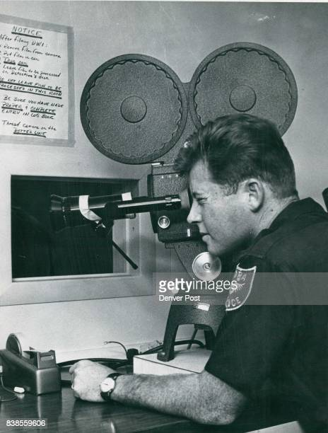 Patrolman William Logan operates 16mm sound movie camera used in sobriety tests Suspects must pick up coins walk chalkline Camera is used to film...