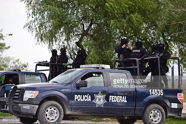 Patrols of the Mexican Federal police are pictured at the highway between Matamoros and Ciudad Victoria in Tamaulipas State on December 16 2015 The...