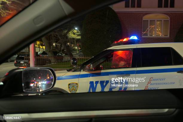 Patrols traffic in the Dyker Heights section of Brooklyn on December 06, 2020 in New York City. The Dyker Heights Christmas-decorated residences are...