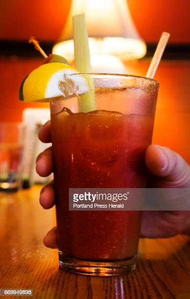 A patron at Bayside American Cafe clutches a Bloody Mary during brunch at the Portland restaurant on Sunday April 9 2017