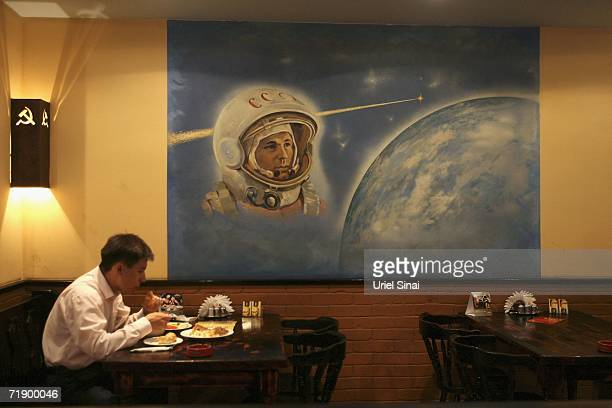 A patron eats under a painting of Yuri Gagarin in the CCCP restaurant which was opened three years ago and decorated with Soviet and Communist...