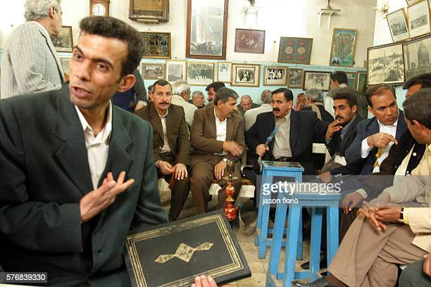 A patron engages in a discussion at the Sh'ah Bander cafe At the Sh'ah Bander cafe poets writers and journalists meet every Friday to exchange...