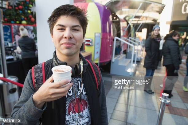 A patron enjoys hot chocolate during the 'Did You Check eBay' Holiday Airstream tour at Westlake Center Plaza on December 9 2017 in Seattle Washington
