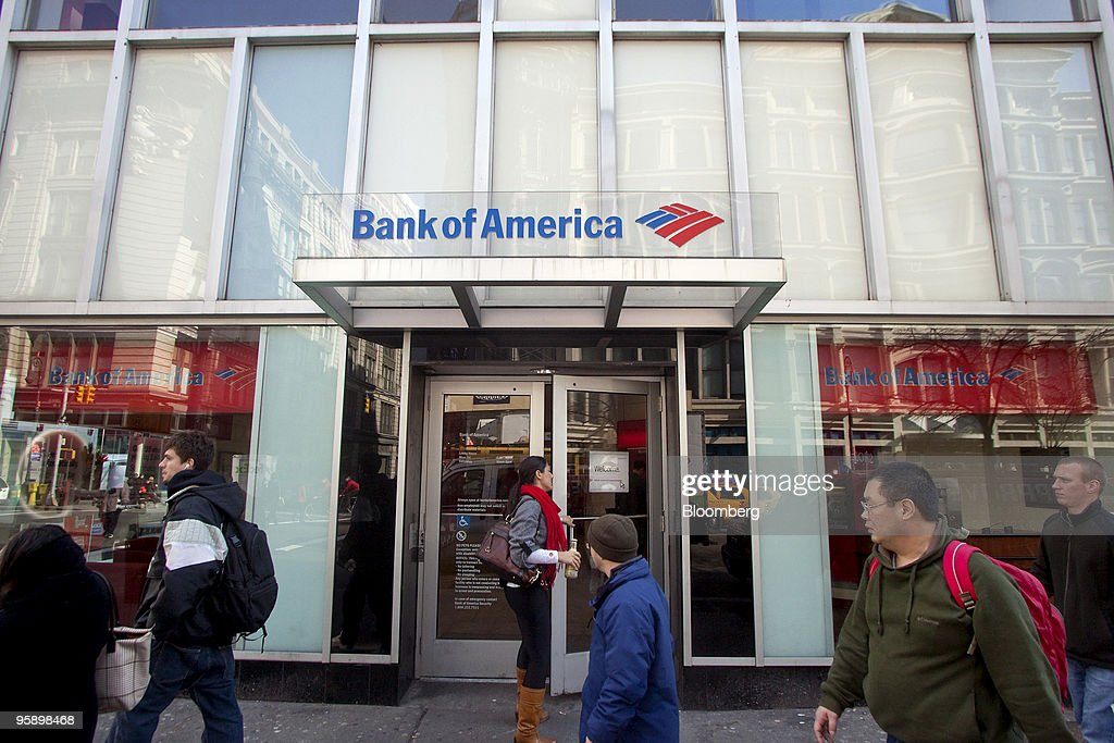 A patron enters a Bank of America branch in New York, U.S., on Wednesday, Jan. 20, 2010. Bank of America Corp., the largest U.S. lender, posted a quarterly loss and its first full-year deficit in more than two decades, driven by the cost of repaying U.S. bailout money and defaults on consumer loans. Photographer: JB Reed/Bloomberg via Getty Images