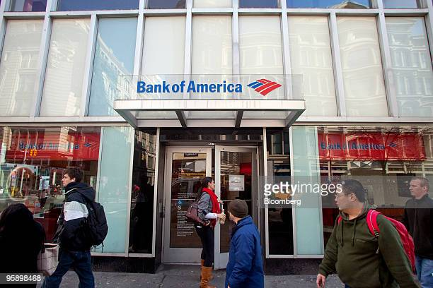 A patron enters a Bank of America branch in New York US on Wednesday Jan 20 2010 Bank of America Corp the largest US lender posted a quarterly loss...