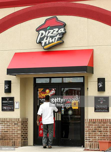 A patron enters a cigarettesmokefree Pizza Hut restaurant August 15 2005 in Niles Illinois Louisville Kentuckybased Yum Brands' companyowned 1200 KFC...