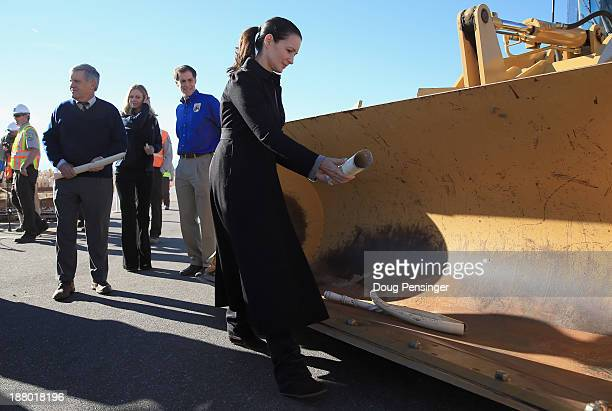Patron for the David Sheldrick Wildlife Trust, actress Kristin Davis, delivers an item of ivory to a rock crusher as the U.S. Fish and Wildfire...