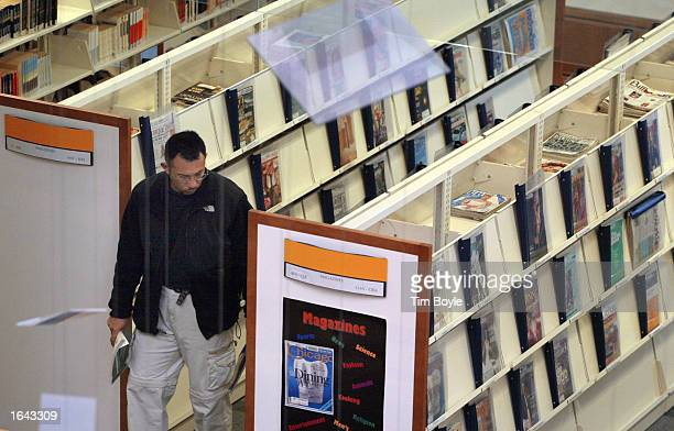 A patron peruses the magazine section at the Des Plaines Public Library November 14 2002 in Des Plaines Illinois The US Supreme Court has agreed to...