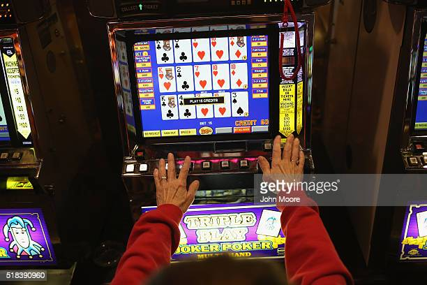 Patron plays the slots at the Trump Taj Mahal casino hotel on March 30, 2016 in Atlantic City, New Jersey. The Atlantic City municipality is due to...