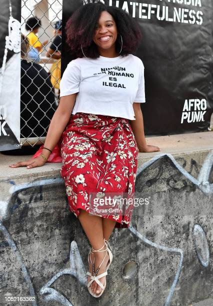 A patron poses for a photo during 2018 AfroPunk Festival Atlanta Carnival of Consciousness at 787 Windsor on October 14 2018 in Atlanta Georgia