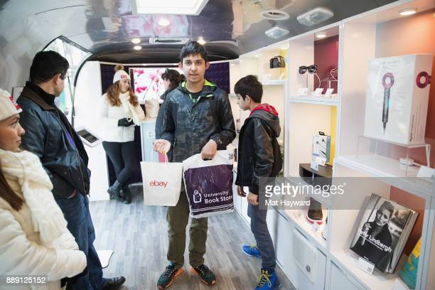 A patron shows off his eBay Claw Machine prize bag during the 'Did You Check eBay' Holiday Airstream tour at Westlake Center Plaza on December 9 2017...