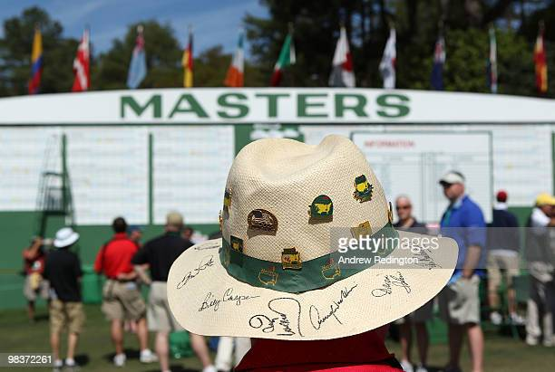A patron waits near the clubhouse during the third round of the 2010 Masters Tournament at Augusta National Golf Club on April 10 2010 in Augusta...