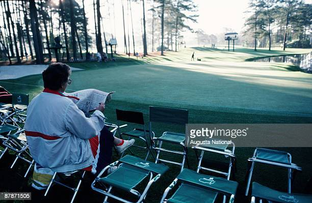Patron waits on the 16th green during the 1988 Masters Tournament at Augusta National Golf Club in April 1988 in Augusta Georgia