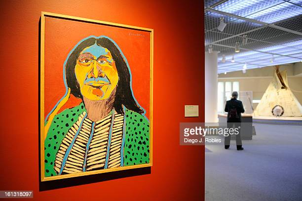 A patron walks by work of artist Fritz Scholder in the Denver Art Museum on Tuesday May 11 2010 Diego James Robles The Denver Post