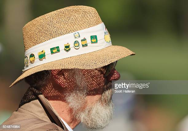 A patron watches the play on the 12th hole during the final round of the 2016 Masters Tournament at the Augusta National Golf Club on April 10 2016...