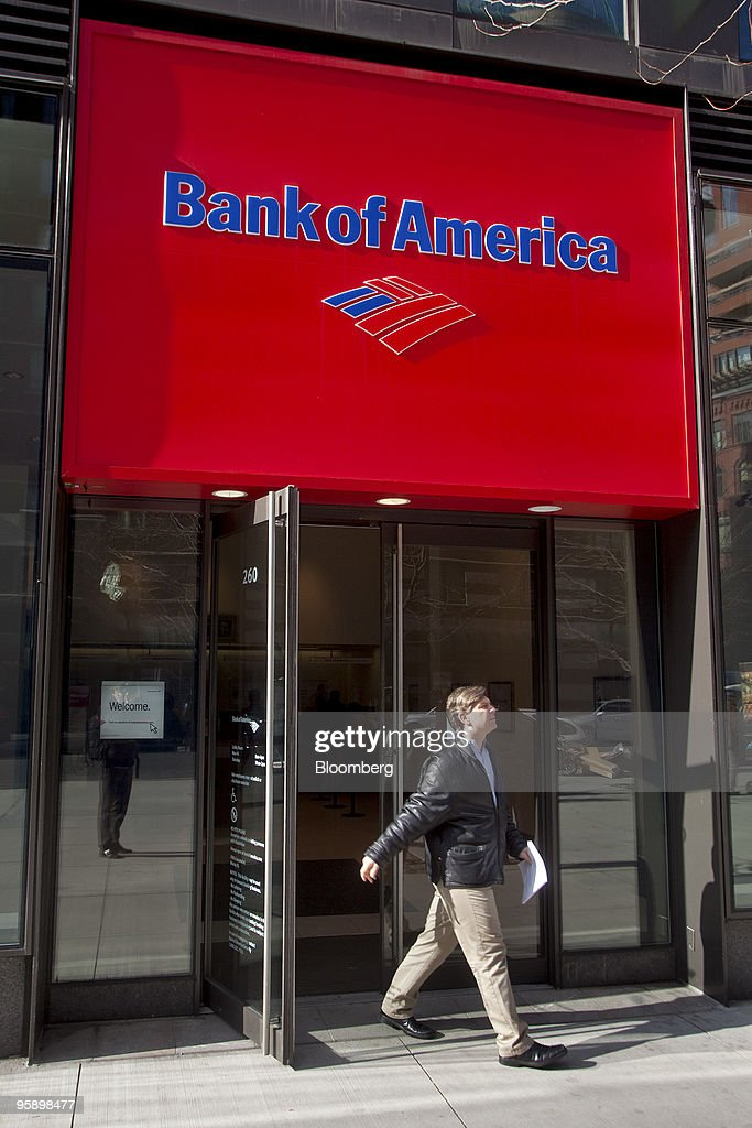 A patron who declined identification leaves a Bank of America branch in New York, U.S., on Wednesday, Jan. 20, 2010. Bank of America Corp., the largest U.S. lender, posted a quarterly loss and its first full-year deficit in more than two decades, driven by the cost of repaying U.S. bailout money and defaults on consumer loans. Photographer: JB Reed/Bloomberg via Getty Images