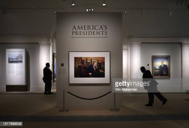 Patrons and security guards view a portrait of former U.S. President Donald Trump in the America's Presidents exhibition at the National Portrait...