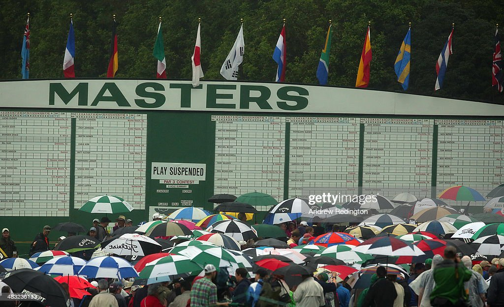 Patrons are evacuated from the course after play was suspended due to weather during a practice round prior to the start of the 2014 Masters Tournament at Augusta National Golf Club on April 7, 2014 in Augusta, Georgia.
