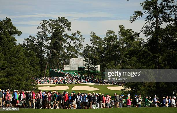 Patrons are seen on the seventh hole during the final round of the 2016 Masters Tournament at the Augusta National Golf Club on April 10 2016 in...