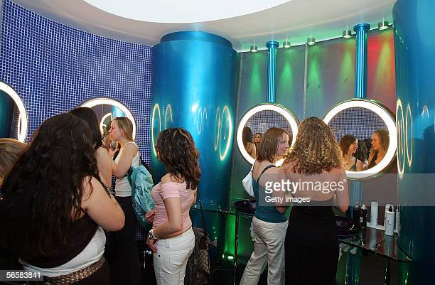 Patrons are shown in the unisex rest room of the Seamless Adult Ultra Lounge during the club's grand opening early December 18 2005 in Las Vegas...
