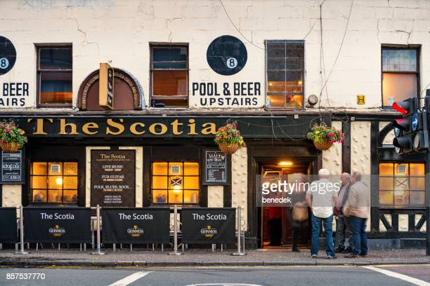 patrons at a pub in downtown glasgow scotland uk - glasgow scotland stock pictures, royalty-free photos & images