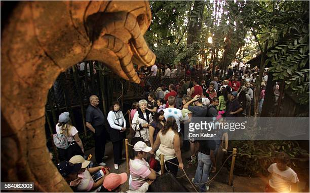 Patrons at Disneyland file through the excavation site while in line at the Indiana Jones Temple of the Forbidden Eye attraction Disneyland is a...