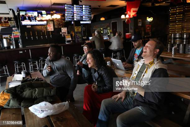 Patrons at The Midlands bar laugh while watching congressional testimony by US President Donald Trump's former attorney and fixer Michael Cohen...
