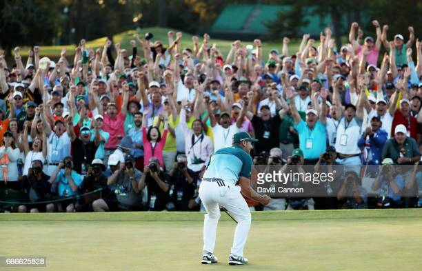 Patrons cheer as Sergio Garcia of Spain celebrates after defeating Justin Rose of England on the first playoff hole during the final round of the...