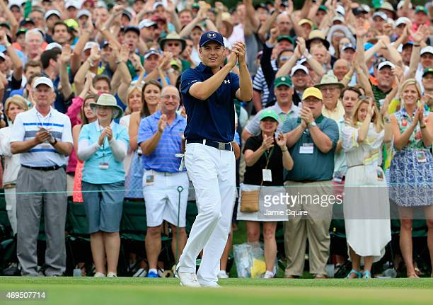 Patrons cheer for Jordan Spieth of the United States on the 18th green after his fourstroke victory at the 2015 Masters Tournament at Augusta...