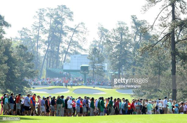 Patrons cross a fairway during a practice round prior to the start of the 2017 Masters Tournament at Augusta National Golf Club on April 4 2017 in...