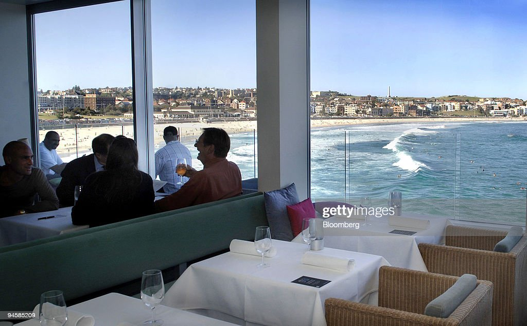 Patrons Dine At Icebergs Dining Room And Bar Which Is Perched On The  Southern Headland Of