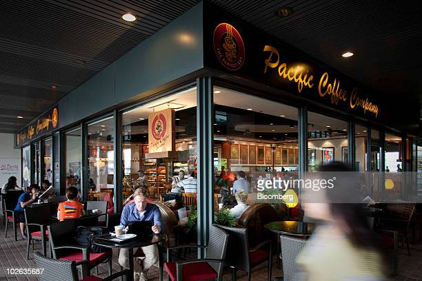 Patrons drink coffee at a Pacific Coffee Group store in Hong Kong, China, on Tuesday, July 6, 2010. China Resources Enterprises Ltd., the...