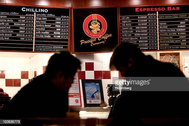 Patrons drink coffee inside a Pacific Coffee Group store in Hong Kong, China, on Tuesday, July 6, 2010. China Resources Enterprises Ltd., the...