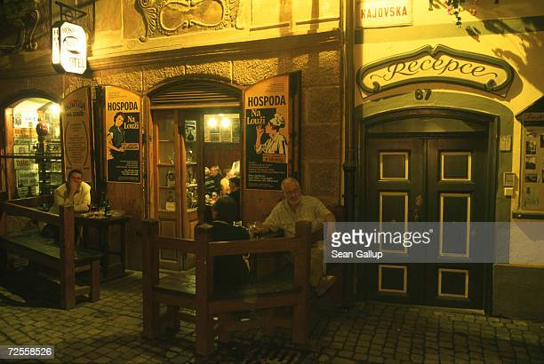 Patrons ejoy a warm evening at a pub August 17 2000 in Cesky Krumlov in the southern Czech Republic Cesky Krumlov a 14thcentury town that one...