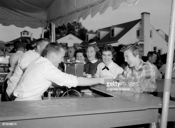 Patrons enjoy laughs during the 1956 Masters Tournament at Augusta National Golf Club in April 1956 in Augusta Georgia
