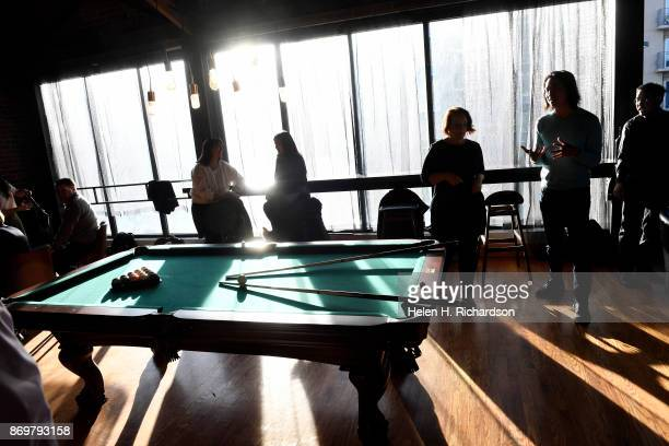 DENVER CO OCTOBER 24 Patrons enjoy the warm afternoon light as it filters through lounge at the new bar called SneekEazy on October 24 2017 in Denver...